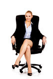 Young smile business woman sitting on a chair in office Stock Photo