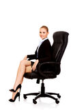 Young smile business woman sitting on a chair in office Royalty Free Stock Photos