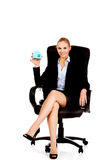 Young smile business woman sitting on a chair in office Stock Photos