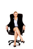 Young smile business woman sitting on a chair in office.  Royalty Free Stock Photo