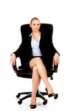Young smile business woman sitting on a chair in office.  Stock Images