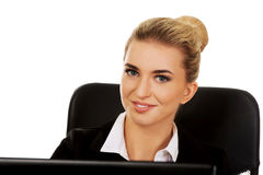 Young smile businesswoman behind the desk, using laptop Royalty Free Stock Image