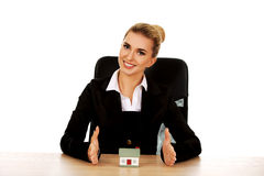 Young smile businesswoman presenting a model house Stock Image