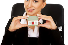 Young smile businesswoman presenting a model house Stock Photo