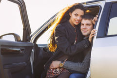 Young smile couple romantic sitting in car Stock Photography