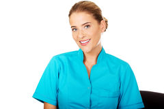Young smile dietician standing behind the desk Stock Photo