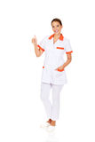 Young smile female doctor or nurse with thumbs up Royalty Free Stock Photography