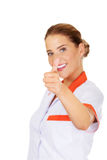 Young smile female doctor or nurse with thumbs up Royalty Free Stock Image
