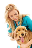 Young smile female veterinarian examinng dog Royalty Free Stock Image