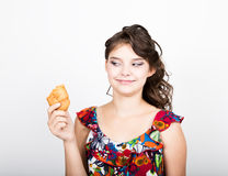 Young smile girl holding and biting bread roll Royalty Free Stock Image