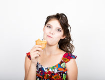 Young smile girl holding and biting bread roll Royalty Free Stock Images