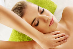 Young smile relaxed woman is massaged Royalty Free Stock Images