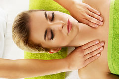 Young smile relaxed woman is massaged Royalty Free Stock Photos