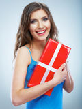 Young smile woman hold red giet box with white ribbon. Stock Photos