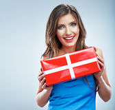 Young smile woman hold red giet box with white ribbon. Stock Image