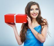 Young smile woman hold red giet box with white ribbon. Royalty Free Stock Photography