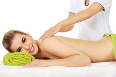 Young smile woman lying on a massage table and has massage. Stock Image