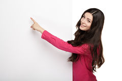 Young smile woman pointing at a blank board Royalty Free Stock Photography