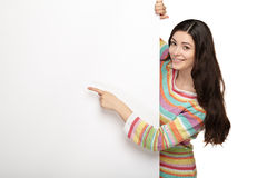 Young smile woman pointing at a blank board Stock Image