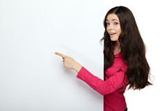 Young smile woman pointing at a blank board Stock Images