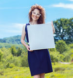 Young smile woman showing blank pane Stock Images