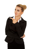 Young smiled businesswoman pointing her finger Stock Image