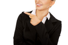 Young smiled businesswoman pointing her finger Royalty Free Stock Photo