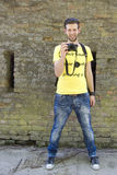 Young smiled man taking a photo in yellow t-shirt Royalty Free Stock Image