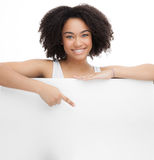 Young Smileing teenager african girl hold black blank paper and shows on it. Stock Photos