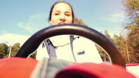 Young smiles beautiful woman driving ATV, hand hold steering wheel in slowmotion. 1920x1080 stock video footage