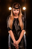 Young smiley beautiful girl on the stage. Portrait of young smiley beautiful long hair girl in black dress with on the stage Royalty Free Stock Image