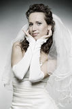 Young smiley bride in wedding dress Stock Image