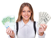 Young and smiley businesswoman holding money Stock Photo