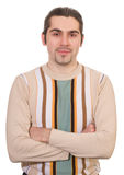 Young smiley handsome male in sweater isolated. Young smiling dark haired caucasian man in striped sweater isolated on white Stock Images