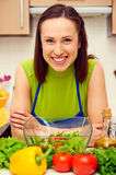 Young smiley housewife standing Royalty Free Stock Image