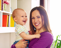 Smiley mother and adorable son at home Stock Photo