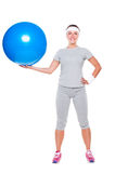 Young smiley woman with ball Royalty Free Stock Images