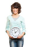 Young smiley woman with clock Stock Photos