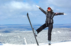 Young smiley woman skier. Young smiley woman in ski sunglasses over mountains landscape Stock Photography