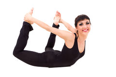Young smiling acrobat posing. Against isolated white background Royalty Free Stock Photos