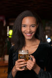 Young smiling african american holding beer royalty free stock photo