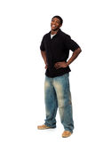 Young smiling African American male standing on a white backgrou Royalty Free Stock Images