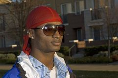 Young smiling African American man in sunglasses Stock Photos
