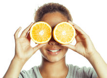 Young smiling afro american woman with half oranges, lifestyle concept isolated on white background Royalty Free Stock Photos