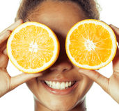 Young smiling afro american woman with half oranges, lifestyle concept isolated on white background Royalty Free Stock Image