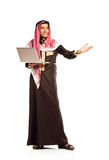 Young smiling arab with laptop isolated on white Royalty Free Stock Images