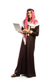 Young smiling arab with laptop isolated on white Stock Photo