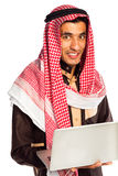 Young smiling arab with laptop isolated on white Royalty Free Stock Photo