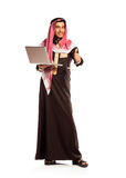 Young smiling arab with laptop isolated on white Royalty Free Stock Photos