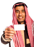 Young smiling arab showing business card in hand isolated on whi Stock Images
